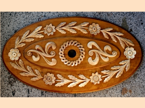 Wood-carved rosette for ceiling decoration